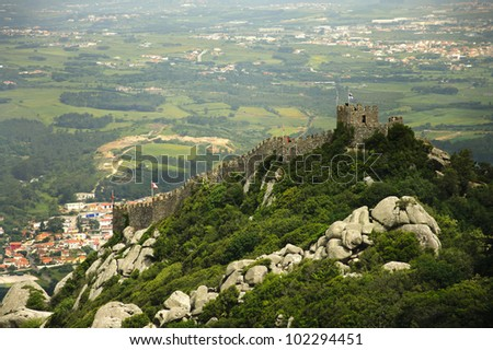 View of the Moors Castle from Palacio da Pena in Sintra, near Lisbon in Portugal. This castle dates from the IX century and is recognized as an UNESCO World Heritage Site since 1995. - stock photo