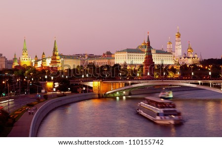View of the Moscow Kremlin and Bolshoy Kamenny Bridge at night - stock photo