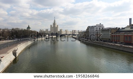 View of the Moscow River and the high-rise on the Kotelnicheskaya Embankment, Big Ustyinsky bridge in spring Stock photo ©