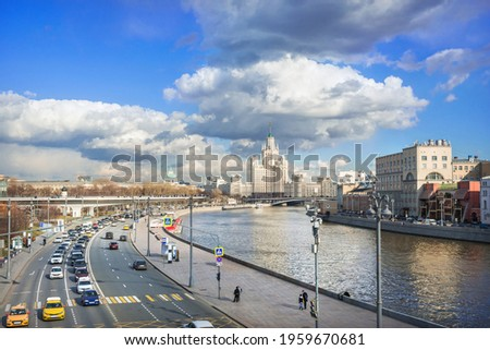View of the Moskva River and the skyscraper on Kotelnicheskaya Embankment from the Bolshoy Kamenny Bridge in Moscow on a sunny spring day Stock photo ©