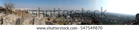 View of the mosque and ramparts at Golcanda Fort overlooking the city of Hyderabad, India. The Medieval fortress was built during the Mughal Empire. #547549870