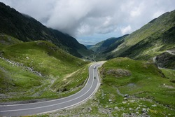 View of the mountain road Transfagarashan, also known as Ceaushescu's Folly which cross the Fagarash ridge in the Carpathian Mountains in Romania. The most beautiful mountain road in Europe.
