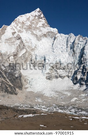 View of the Mt. Everest region from Gorak Shep to Kala Patthar and Pumo Ri, Nepal - stock photo