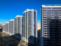 View of the new beautiful residential complex from new buildings with buildings houses monolithic concrete frame panel multi-story skyscrapers of the big city of the metropolis.