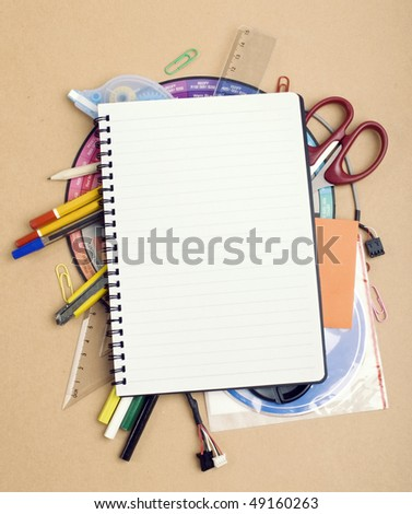 View of the office tools on yellow background