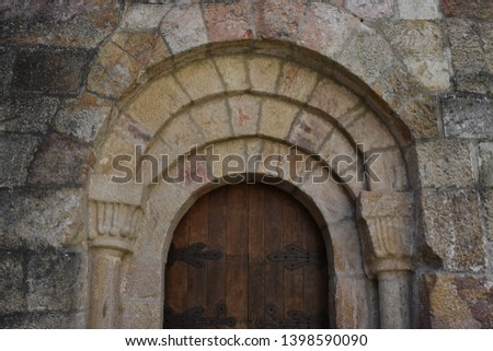 View of the old entrance door of the Monastery of San Salvador of Leyre (Monasterio de San Salvador de Leyre) in Navarre, Spain. It was sculpted in the 12th century