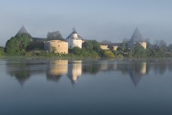View of the Old Ladoga Fortress on a foggy June morning. Leningrad region, Russia