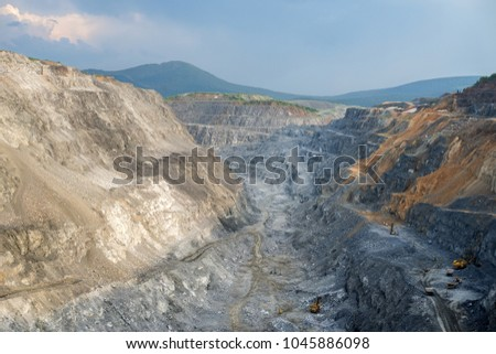 View of the open-pit mine from above. The quarry operation  is located in the village of Belogorsk, Kemerovo region. Siberia, Russia. #1045886098