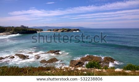 Shutterstock View of the Os Castros Beach (Playa de los Castros) in Ribadeo, Galicia - Spain