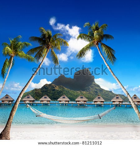 View of the Otemanu mountain through the palms with hammock and ocean. Bora-Bora. Polynesia