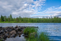 View of The Ounasjoki River in summer evening, Levi, Lapland, Finland