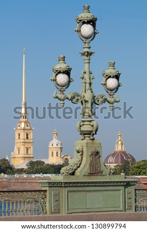 view of the Peter and Paul Fortress and the lantern on the bridge on a sunny day