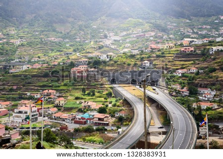 View of the picturesque mountain view from the village of Madeira (Portugal) with highways, bridges, highways and tunnels. #1328383931