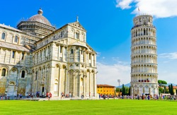 View of the Pisa Cathedral and the Leaning Tower in a sunny day in Pisa, Italy.