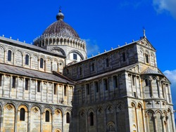 View of the Pisa Cathedral (Duomo di Pisa) in Pisa, Italy. It is located in Miracoli Square (Piazza dei Miracoli).