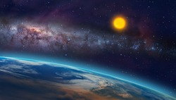 View of the planet Earth from space during a sunrise against milkyway galaxy and sun