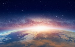 View of the planet Earth from space during a sunrise against milkyway galaxy