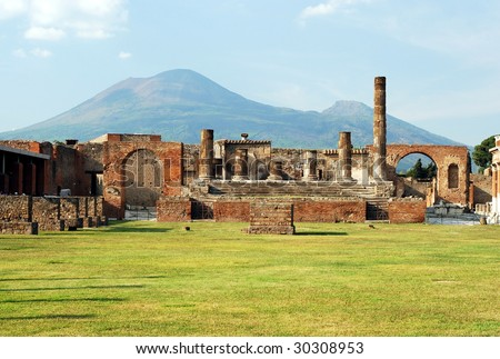 View of the Pompeii ruins in italy with Mount Vesuvius in background.