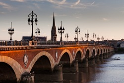 View of the Pont de pierre at sunset in the famous winery region Bordeaux, France