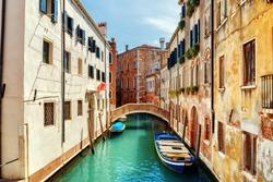 View of the Ponte de L Anatomia and the Rio de San Zan Degola Canal from the Ponte de Ruga Bella o del Forner in Venice, Italy. Venice is a popular tourist destination of Europe.