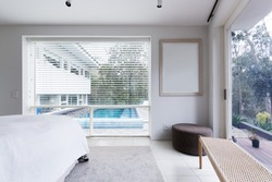 View of the pool and garden  from bedroom in luxury Australian home