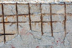 View of the poor concrete cover and corrosion of reinforcement bars. Concrete can be damaged by physical damage and chemical damage (from carbonatation, chlorides, sulfates and non-distilled water).
