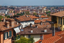 View of the redroof historical buildings in the Bergamo in northern Italy. Bergamo is a city in the Lombardy region.