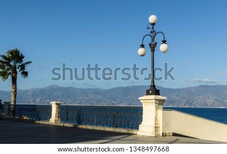 View of the Reggio di Calabria promenade Lungomare Falcomata and Strait of Messina connected Mediterranean and Tyrrhenian sea and Sicily island background, Reggio Calabria, Italy #1348497668