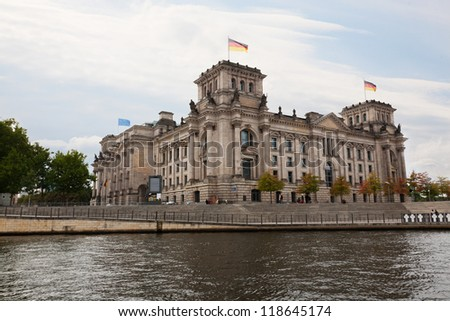 View of the Reichstag from the river Spree in cloudy weather