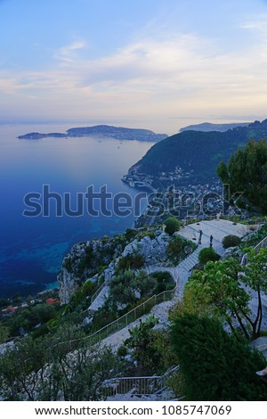 View of the resort town of Eze-sur-Mer on the Mediterranean Sea seen from the ancient fortified mountain village of Eze in Provence, French Riviera, France