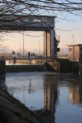 View of the River Dender and Denderbelle Sluis on a winters morning. The 'Sluis' is a boat lock near Dendermonde in East Flanders, Belgium