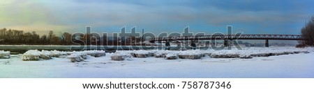 view of the river with blocks of ice on the bridge  #758787346