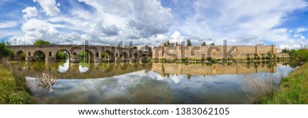 View of the Roman bridge of Merida with its reflection on the Guadiana river. Merida. Spain.The Archaeological Ensemble of Merida is declared a UNESCO World Heritage Site Ref 664. Panorama image from