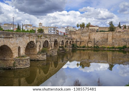 View of the Roman bridge of Merida with its reflection on the Guadiana river. Merida. Spain.The Archaeological Ensemble of Merida is declared a UNESCO World Heritage Site Ref 664