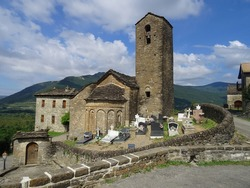 View of the Romanesque Church of San Martin and the cemetery in the village of Olivan. Serrablo Region. Aragon. Spain.