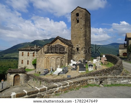 View of the Romanesque Church of San Martin and the cemetery in the village of Olivan. Serrablo Region. Aragon. Spain. stock photo