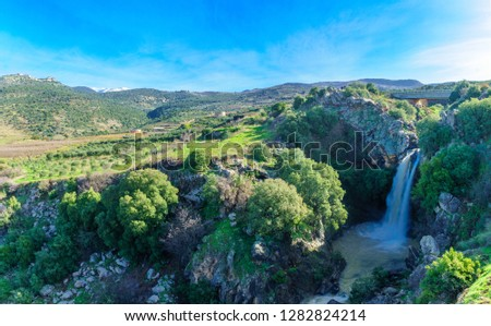 View of the Saar Waterfall, with Mount Hermon and Nimrod Fortress in the background, in the Golan Heights, Morthern Israel #1282824214