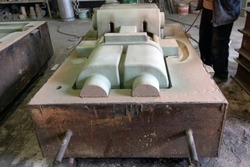 View of the sand mold for steel casting. Sand casting, also known as sand molded casting, is a metal casting process characterized by using sand as the mold material.
