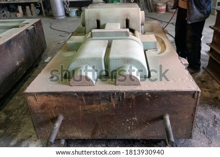 View of the sand mold for steel casting. Sand casting, also known as sand molded casting, is a metal casting process characterized by using sand as the mold material. ストックフォト ©
