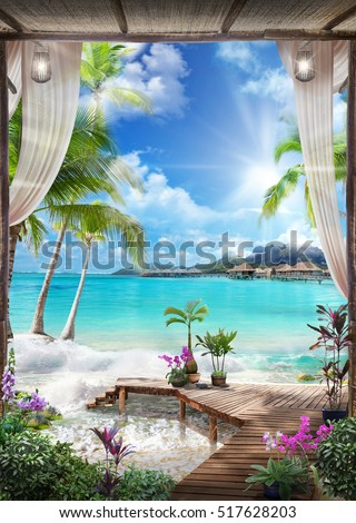 stock photo view of the sea from the old arches palms sun flowers and transparent curtains with flashlights 517628203 - Каталог — Фотообои «Балконы, арки»