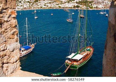 view of the sea with yachts through the wall of the castle in Bodrum, Turkey