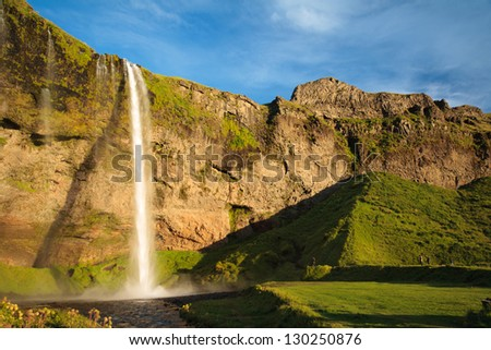 view of the Seljalandsfoss waterfall in Iceland