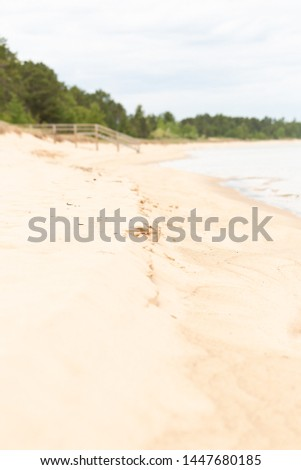 View of the shoreline along AuTrain beach- Small sand cliffs are formed  as Lake Superior washes on to shore-Pictured Rocks National Lakeshore-Michigan