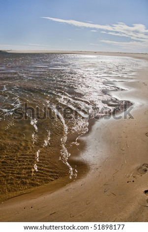 View of the shoreline of a beautiful beach on the Algarve, Portugal.