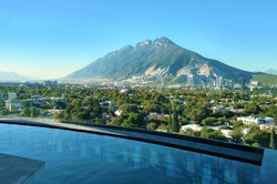 View of the Sierra Las Mitras from an infinity pool in Monterrey, Mexico