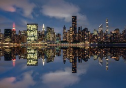 View of the skyline of Manhattan, New York, USA, at night, from the Dumbo area. Photography, reflection effect