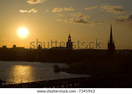 View of the skyline of Stockholm with the Riddarholm church (right hand side) and the city hall (Stadshuset; in the middle). - stock photo