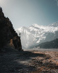 View of the snowy Himalayas from a dried out riverbed