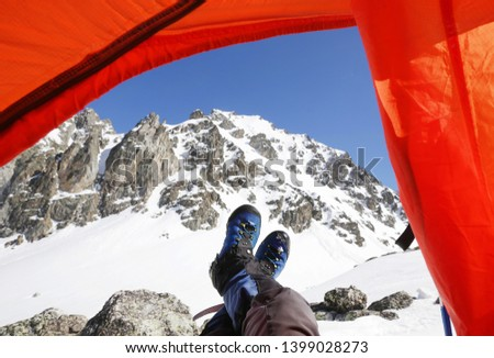 view of the snowy mountains from the tent  #1399028273