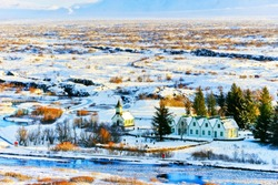 View of the snowy plateau in winter at Thingvellir National Park in Iceland.